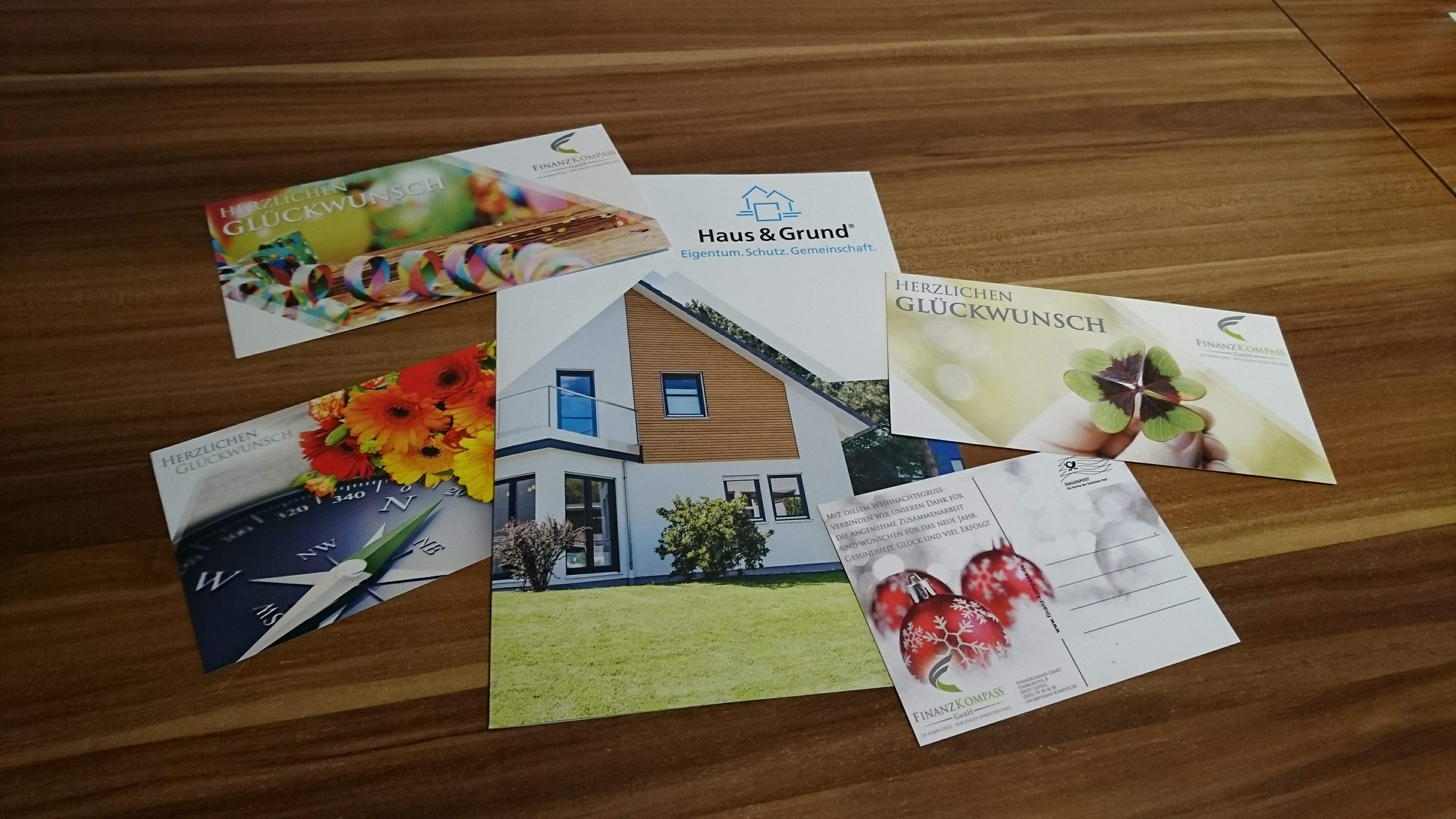 Finanz Kompass GmbH - Folder, Unternehmensbroschüre, Gestaltung Glückwunschkarten, Postkarten Design DIN A6